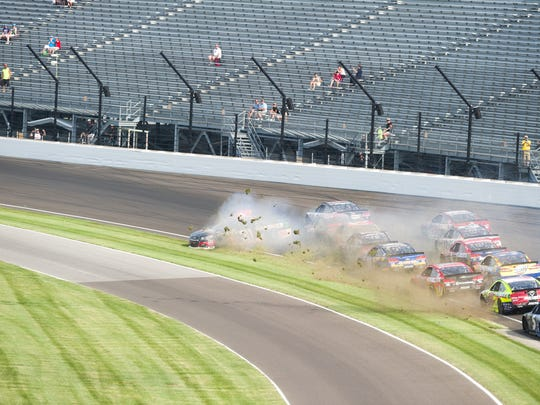 Cars tangle in turn one following a restart of the race during the running of the 23rd annual Brickyard 400, Sunday, July 24, 2016.