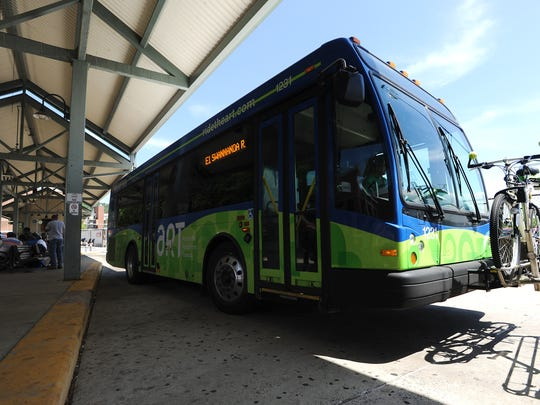 An Asheville city bus leaves the transit depot.