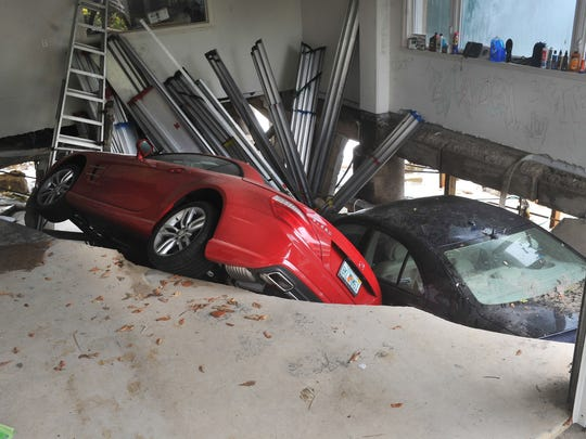 Two Mercedes Benz were swallowed in a garage on Hutchinson