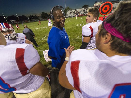 Martinsville assistant coach Ralston Evans talks with