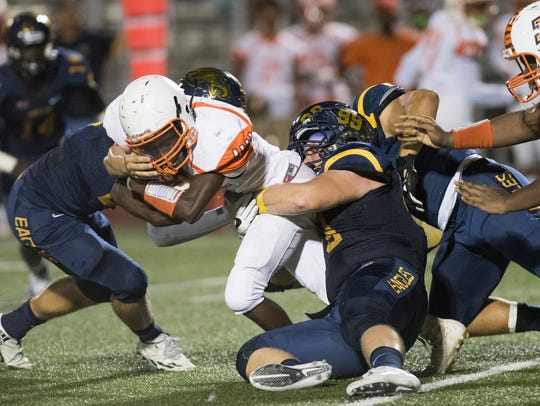 The Naples defense wraps up Sunrise-Piper running back