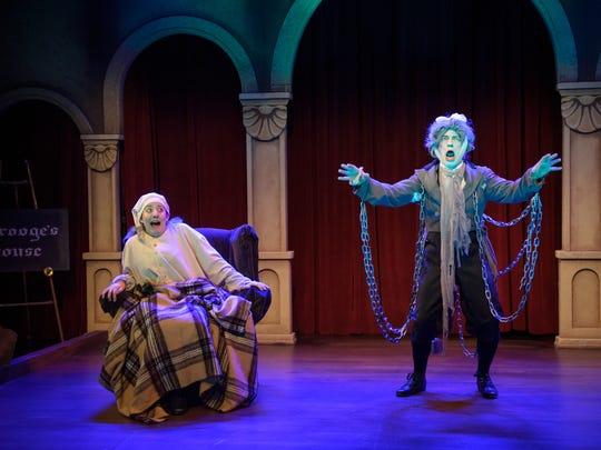 "Elyse Edelman (left) freaks out when Chris Flieller appears in ""Scrooge in Rouge,"" performed by In Tandem Theatre."