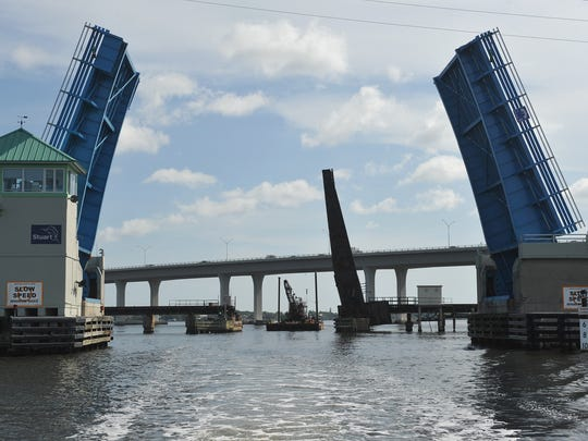 Old Roosevelt Bridge is seen in front of the train bridge that spans over the St. Lucie River in Stuart.