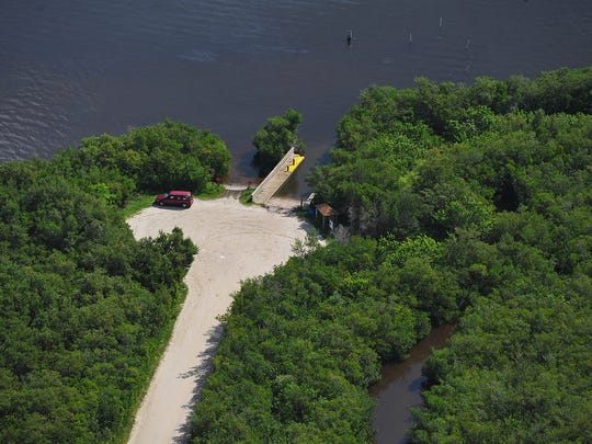 Indian River County Commissioners have embraced a scaled-back version of dredging muck from the ramp toward the Intracoastal Waterway in the middle of the lagoon and upgrading Oslo Road. This aerial view of the ramp was taken in 2014.