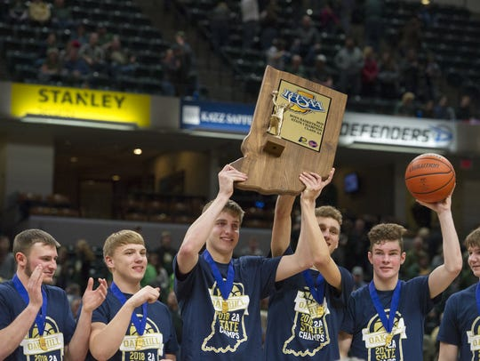 Oak Hill High School players celebrate with the trophy