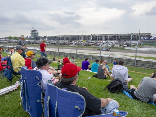 Fans watch the action on the track during the running