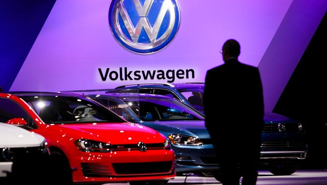 A man looks at the Volkswagen display at the 2016 New York International Auto Show.