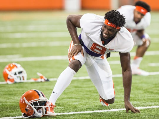 Clemson wide receiver Deon Cain stretches before a