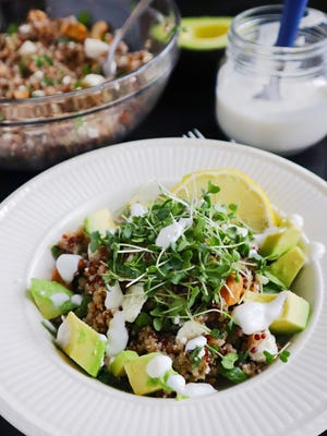 Garnished with avocado and broccoli microgreens, this grain bowl is a satisfying meal any time of day.