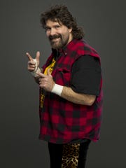 File: Professional wrestling star Mick Foley was ejected from Philadelphia's Wing Bowl eating contest after stuffing uneaten chicken wings into a fanny pack in an attempt to increase his total.