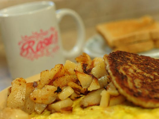 Sausage patty, American fries, scrambled eggs, whole wheat toast and a cup of coffee at Rosie's.