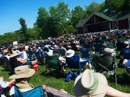 Music lovers listen to a band at Granite Hill Camping Resort during the Gettysburg Bluegrass Festival.