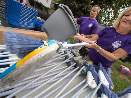 Barbara Shepp of the York Elks gets the brooms ready as the lodge gives away cleaning supplies.