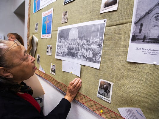Virginia Hunter looks over the bulletin board she put up about the merger with Faith, at First Presbyterian Sunday Ocober 18, 2015. Faith and First Presbyterian Churches merged 50 years ago this Christmas Eve, First Presbyterian October 18, 2015.  Paul Kuehnel - York Daily Record/ Sunday News
