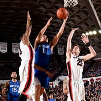 UK guard Devin Booker drives to the basket between Georgia guard Charles Mann (4) and forward Kenny Paul Geno during the first half Tuesday night.