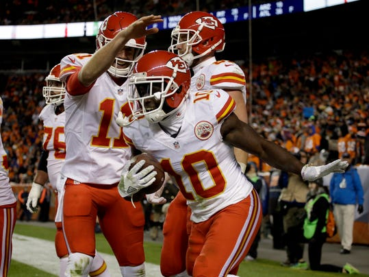 Kansas City Chiefs wide receiver Tyreek Hill (10) celebrates his touchdown against the Denver Broncos with Alex Smith (11) during the second half of an NFL football game, Sunday, Nov. 27, 2016, in Denver. (AP Photo/Joe Mahoney)