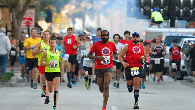 Runners take off during the 2017 Space Coast Marathon in Cocoa.