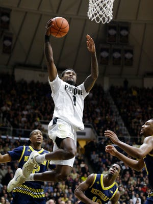 Purdue guard Johnny Hill (1) shoots against the Michigan during the second half of an NCAA college basketball game in West Lafayette, Ind., Thursday, Jan. 7, 2016. Purdue defeated Michigan 87-70. (AP Photo/Michael Conroy)