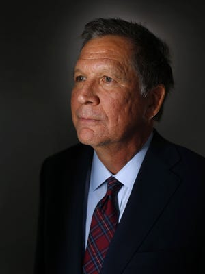 Republican presidential candidate John Kasich, the governor of Ohio, poses for a portrait following his meeting Thursday, Dec. 17, 2015 with The Des Moines Register editorial board in Des Moines.