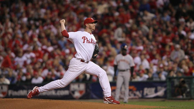 Roy Halladay gets the side out in the first inning with very few pitches. The Philadelphia Phillies host the San Francisco Giants at Citizen's Bank Park in Game 1 of the National League Championship Series on Oct. 16, 2011.