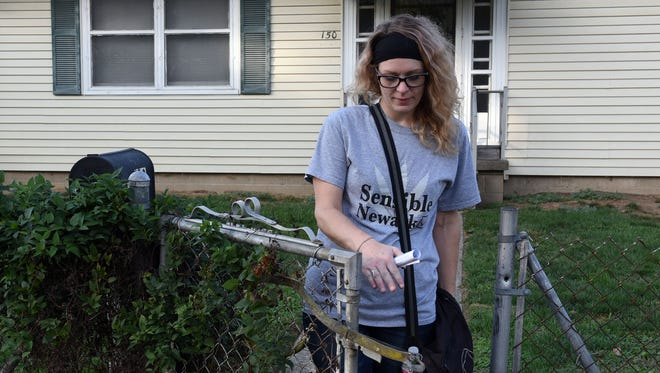 Co-Founder of East Central Ohio Decriminalization Initiative Alissa Baker goes door to door campaigning for the marijuana initiative on the ballot in Newark.