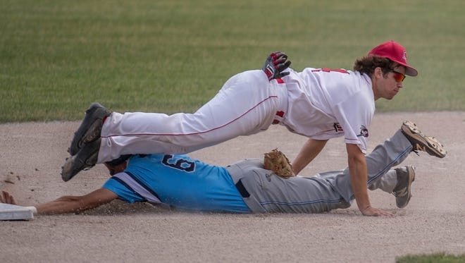 Battle Creek Bombers' Cale Henneman attempts to get the Kalamazoo Growlers runner out on Tuesday.