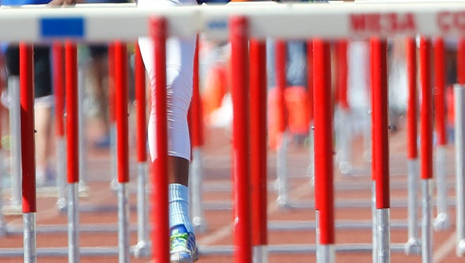 Darren Dorsey of Thunderbird wins the Division II, 100-meter hurdles championship during the state track and field championships at Mesa Community College on Saturday, May 10, 2014.