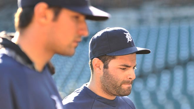 Tigers catcher Alex Avila, right, returned to the lineup Monday night against the White Sox. He's been out since Sept. 14.