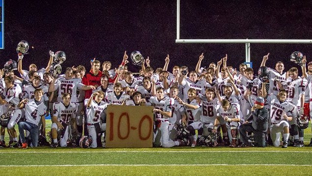 Pisgah JV football players celebrate after Thursday's win at Brevard.