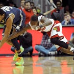 Mar 4, 2015; Louisville, KY, USA; Notre Dame Fighting Irish forward Bonzie Colson (35) scrambles for the ball with Louisville Cardinals guard Terry Rozier (0) during the first half at KFC Yum! Center. Mandatory Credit: Jamie Rhodes-USA TODAY Sports