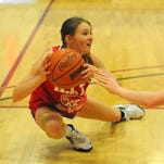 Belt's Sara Anderson looks for a teammate while falling to the ground after a loose ball.