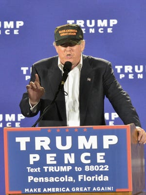 Donald Trump at Maritime Park in downtown Pensacola in November. Trump's executive order to freeze the hiring of federal workers could result in more than 100 military civilian employees losing their jobs as early as this week.