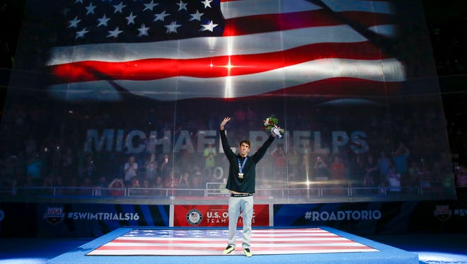 Jun 29, 2016: Michael Phelps reacts at the medal ceremony during  the U.S. Olympic Swimming Team Trials at CenturyLink Center.