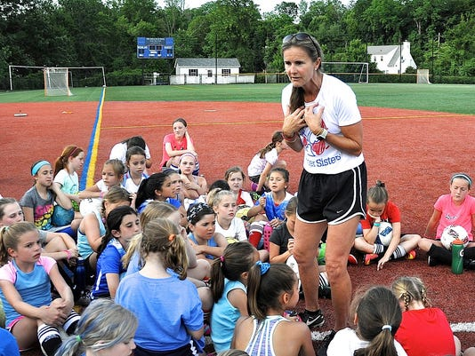 Brandi Chastain tells girls to fight for dreams