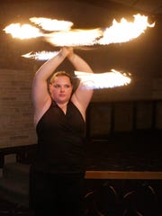 Valerie Ringwell of Sheboygan works a fire baton during