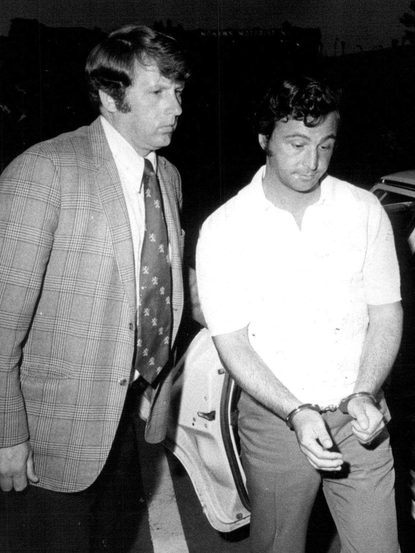 """""""Sammy G"""" Gingello in custody in this1975 photo."""