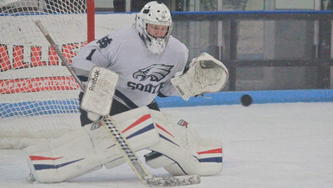Owen Liskiewicz of Middletown South hockey makes a save against RFH.