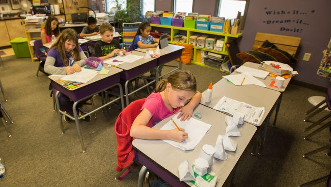 Hiring gains, many of them in local education, led to lower jobless rates for Arizona and the Phoenix area in February. Here, students work in a third-grade classroom at Four Peaks Elementary School, Thursday, March 19th, 2015, in Apache Junction, Ariz.