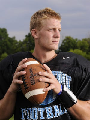 Standout Lansing Catholic Central quarterback Tony Poljan poses for pictures  after practice Wednesday August 18 2015.