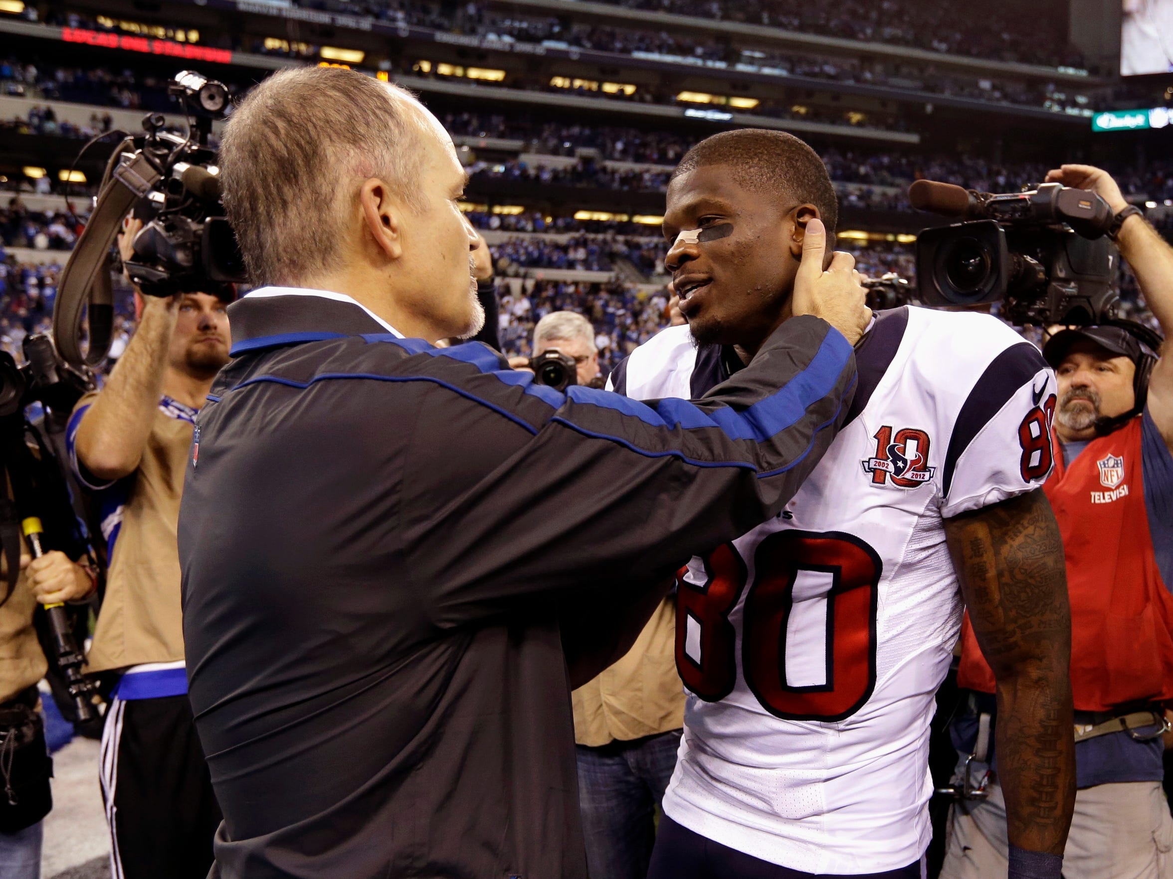 Coach and player remained close long after their Miami days. Here, Pagano, who recruited Johnson to the University of Miami in 1999, greets his former player after a Colts-Texans game in 2012.