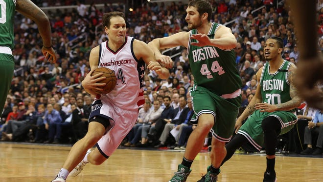 May 4, 2017; Washington, DC, USA; Washington Wizards guard Bojan Bogdanovic (44) drives to the basket as Boston Celtics center Tyler Zeller (44) defends in the fourth quarter in game three of the second round of the 2017 NBA Playoffs at Verizon Center. The Wizards won 116-89. Mandatory Credit: Geoff Burke-USA TODAY Sports
