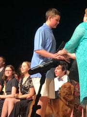 Hudson Golebiewski attended Vestal Middle School's eighth grade graduation ceremony Tuesday evening with his service dog, Oscer.