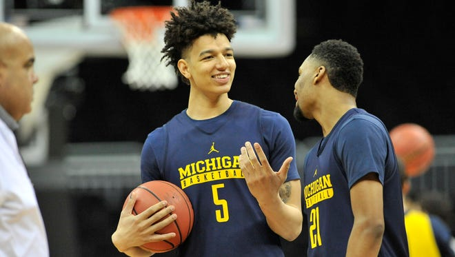 Michigan forward D.J. Wilson (5) talks with guard Zak Irvin (21) during the Michigan workout on the practice day for the NCAA Sweet 16 at Sprint Center in Kansas City, Missouri. on March 22, 2017.