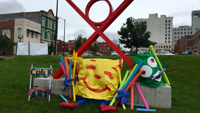 """A """"chalk monsters"""" sculpture at IdeaXfactory celebrates the 2016 Chalk & Art Festival, in which artists and families decorate a parking lot near the IdeaXfactory art space with chalk images. The next festival is scheduled for July 7-8, 2017"""