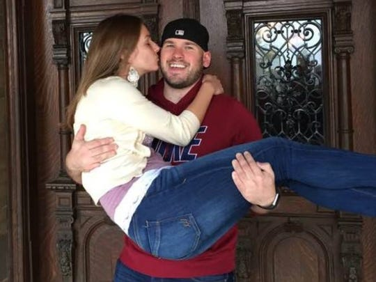 Clenton Hall picks up his girlfriend, Katey Pasqualini, during a visit to the Pabst Mansion in Milwaukee a few weeks before they were killed by a drunken driver.