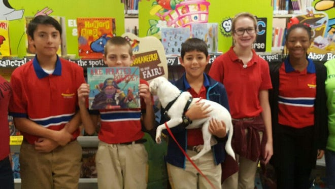 """English teacher Katie Sheehan (from left), Austin Lopez, Marshall Mecham, Rene Esparza, Rhyanne Amthor, Tyli Emanuel and Librarian Amanda Elizondo during School of Science and Technology's """"Roll Over and Read"""" event."""