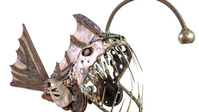 """Josh Price of Dunnellon, Florida, creates sculptures using scrap metal materials. """"I just see what could be, start designing in my mind, find the parts that fit and let it flow and weld it all into place,"""" he says."""