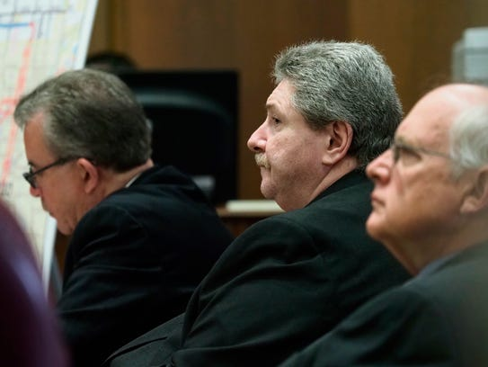 Charles Pickett Jr. listens to testimony during his