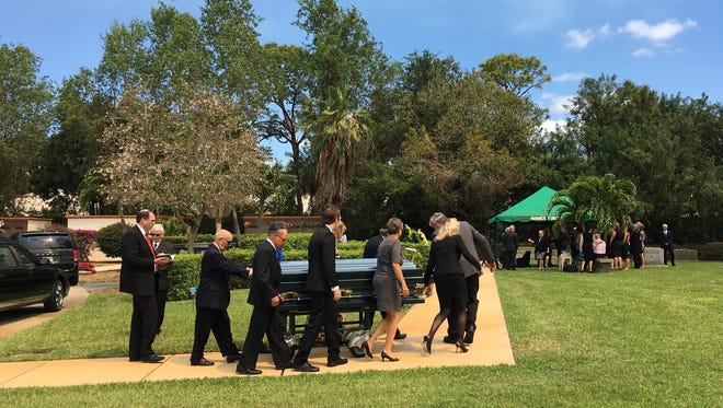Family members carry Truly Nolen's casket to his grave at Hodges Funeral Home at Naples Memorial Gardens on Friday, April 21, 2017. Nolen died Tuesday in his Naples home. He was 89.