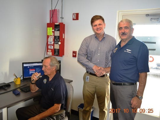From left: Dave Dumas, Justin Lobb and Bob Corriveau at the temporary communications room.